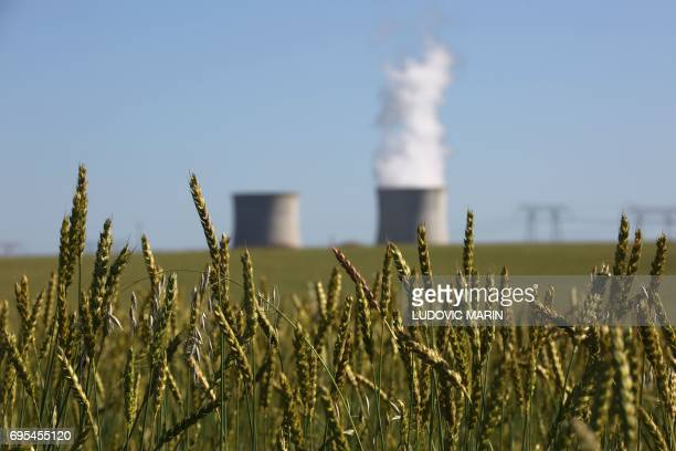 The SaintLaurentdesEaux nuclear power station is pictured behind a wheat field on June 12 2017 in SaintLaurentNouan near Orleans