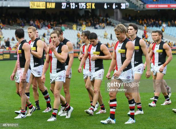 The Saints look dejected as they leave the field after losing the round seven AFL match between the Hawthorn Hawks and the St Kilda Saints at...
