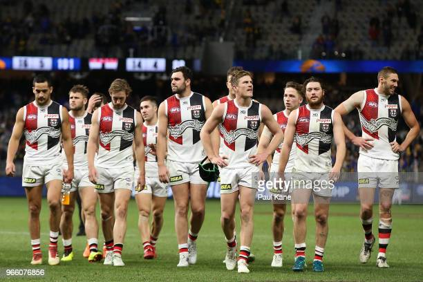 The Saints walk from the field after being defeated during the round 11 AFL match between the West Coast Eagles and the St Kilda Saints at Optus...