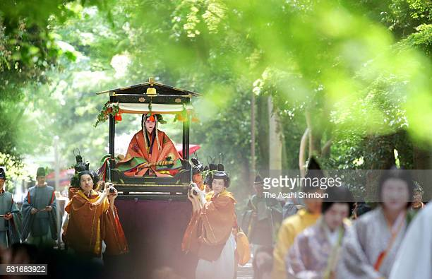 The 'Saiodai' queen principle figure of festival wearing a 12layered ceremonial kimono of Heian Period court ladies called Junihitoe marches on...