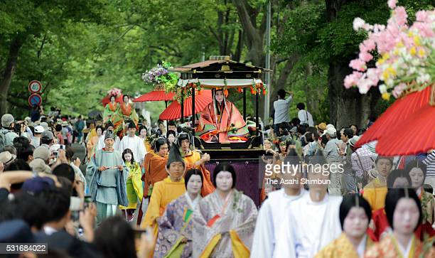 The 'Saio-dai' queen, principle figure of festival wearing a 12-layered ceremonial kimono of Heian Period court ladies called Junihitoe, marches on...