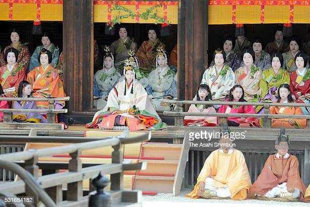 The 'Saiodai' queen principle figure of festival wearing a 12layered ceremonial kimono of Heian Period court ladies called Junihitoe sits on stage in...