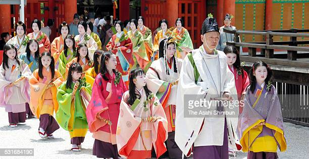 The 'Saio-dai' queen, principle figure of festival wearing a 12-layered ceremonial kimono of Heian Period court ladies called Junihitoe, arrives at...