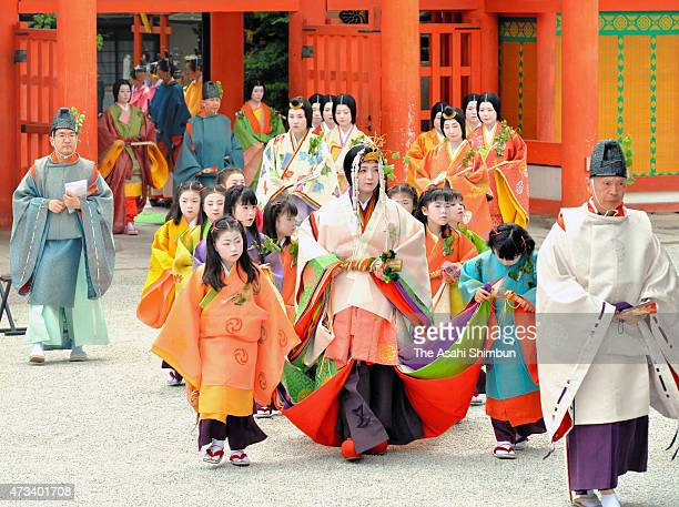 The 'Saiodai' queen wearing 'junihitoe' the layered formal kimono of Heian Period court ladies march on during the Aoi Festival at Shimogamo Jinja...