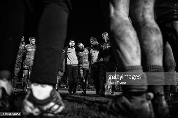 The Sale Sharks side hold a post match huddle during the Gallagher Premiership Rugby match between Bath Rugby and Sale Sharks at The Recreation...