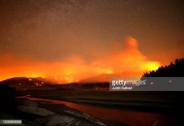 The Salt Fire burns in the hills above Shasta Lake on July 01, 2021 in Lakehead, California. The Salt Fire has burned over 4,600 acres in the past 24...