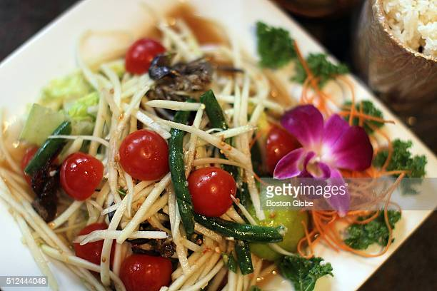 The Salted crab papaya salad with bamboo canister of sticky rice at the restaurant Montien in Boston Feb 16 2016