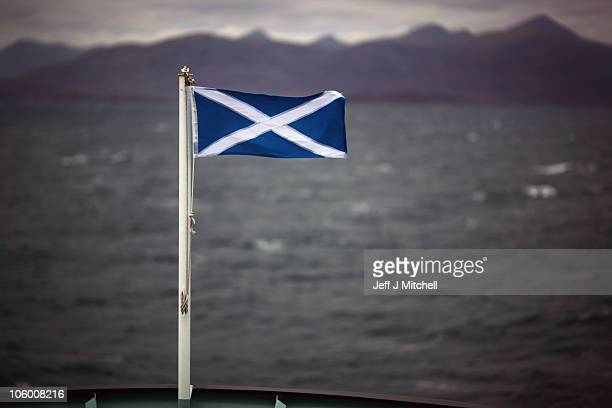 The Saltire flag flutters in the wind on board the Hebrides Caledonian MacBrayne ferry as it makes it way to Harris from Uig on the Isle of Skye on...