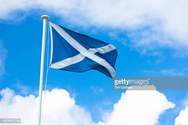 The Saltire national flag of St Andrew flying from flagpole as Scottish Referendum Independence Debate campaign and lobbying urges voters to give a...