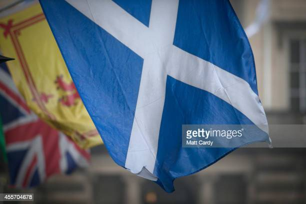 The Saltire the Royal Standard of Scotland and the Union Flag fly above a gift shop in central Edinburgh on September 19 2014 in Edinburgh Scotland...