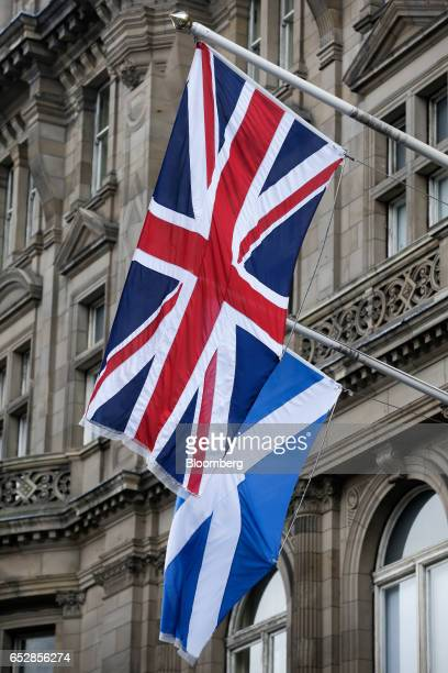 The Saltire the Scottish national flag bottom flies near to a Union flag also known as a Union Jack from a building in Edinburgh UK on Wednesday...