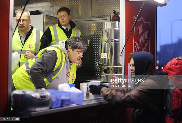 The Salvation Army charity give out free hot drinks to Eurostar train passengers queueing in the cold outside St Pancras International train station...