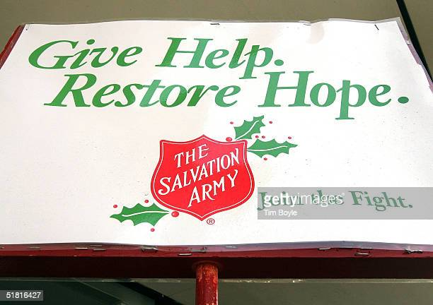 The Salvation Army creed is seen on a bell ringer's pole in front of a Kmart store December 2 2004 in Chicago Illinois Several major national...