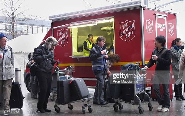 The Salvation Army dispense hot drinks to passengers waiting for flights from Terminal 3 at Heathrow airport on December 21 2010 in London England...