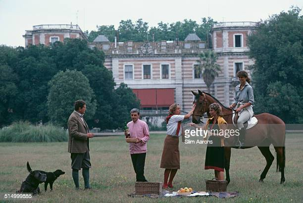 The Salviati family with a domestic worker in the grounds of their family home in Florence, Italy, June 1983. Left to right: Duca Forese Salviati,...