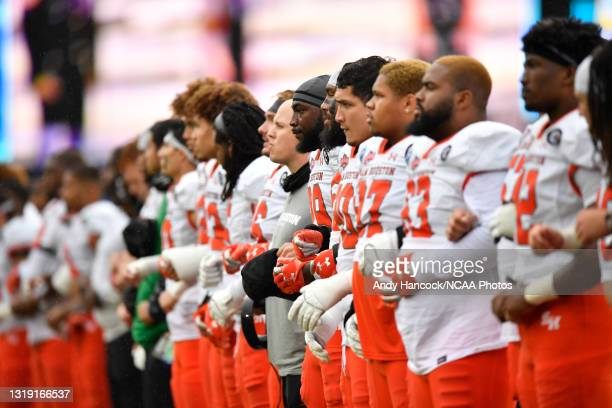 The Sam Houston State Bearkats link arms during the national anthem before the game against the South Dakota State Jackrabbits during the Division I...