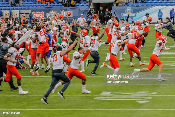 The Sam Houston State Bearkats players sprint onto the field after winning the FCS Championship game between the Sam Houston State Bearkats and the...