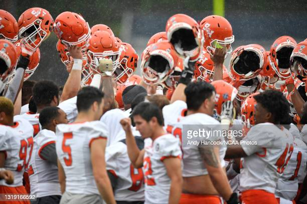 The Sam Houston State Bearkats raise their helmets before they take on the South Dakota State Jackrabbits in the during the Division I FCS Football...