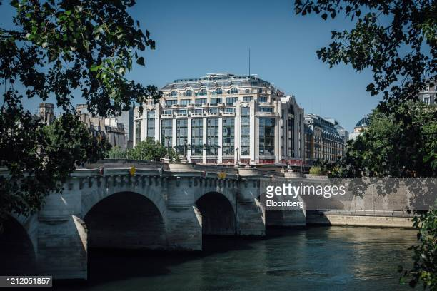 The Samaritaine luxury department store building operated by LVMH Moet Hennessy Louis Vuitton stands beside the River Seine in Paris France on...
