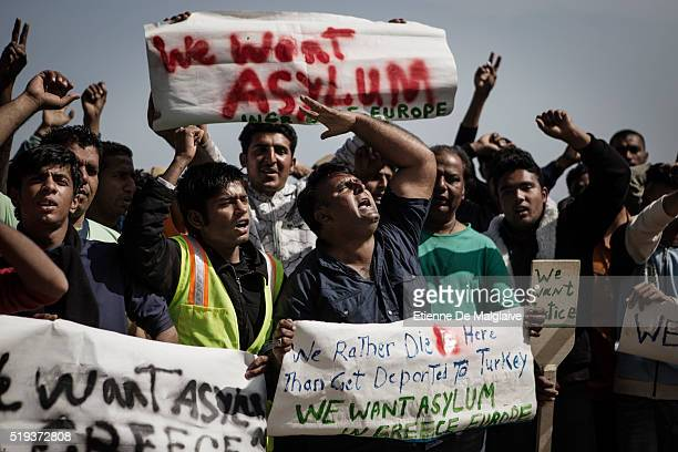 The same day first batch of refugees were deported to Turkey other refugees demonstrate against deportation in a makeshift camp not under control by...