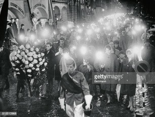 The same day that the murdered John F Kennedy was buried in Arlington National cemetery students paid homage to JFK with a torch light parade as...