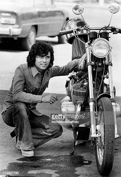 The Sammarinese singer Little Tony born Antonio Ciacci crouched beside a motorbike Rome 1973