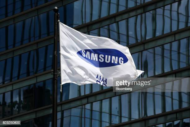 The Samsung Electronics Co corporate flag flies outside the company's Seocho office building in Seoul South Korea on Tuesday July 25 2017 Samsung...