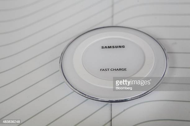 The Samsung Electronics Co Fast Charging wireless pad is displayed during the Samsung Unpacked 2015 event in New York US on Thursday Aug 13 2015...