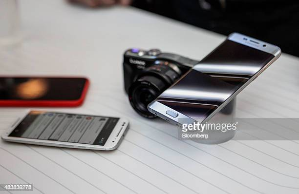 The Samsung Electronics Co Galaxy S6 Edge Plus smartphone right is displayed during the Samsung Unpacked 2015 event in New York US on Thursday Aug 13...