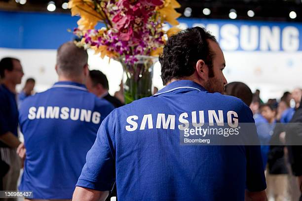 The Samsung Electronics Co logo appears on shirts of company representatives at the 2012 International Consumer Electronics Show in Las Vegas Nevada...
