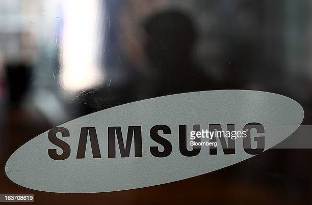 The Samsung Electronics Co logo is displayed at the company's Seocho office building in Seoul South Korea on Friday March 15 2013 Samsung...