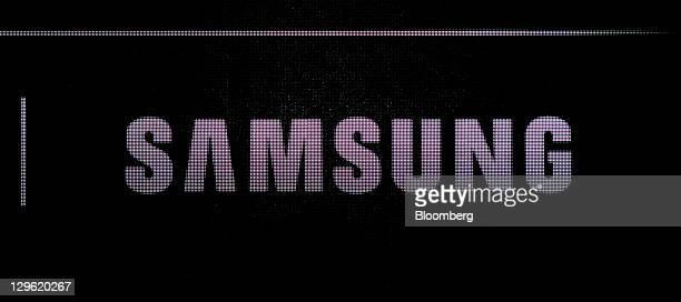 The Samsung Electronics Co logo is displayed during the launch of Samsung's Galaxy Nexus smartphone running Google Inc's Ice Cream Sandwich Android...