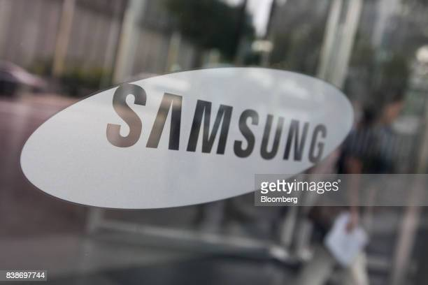 The Samsung Electronics Co logo is displayed in a window at the company's Seocho office building in Seoul South Korea on Friday Aug 25 2017 The...