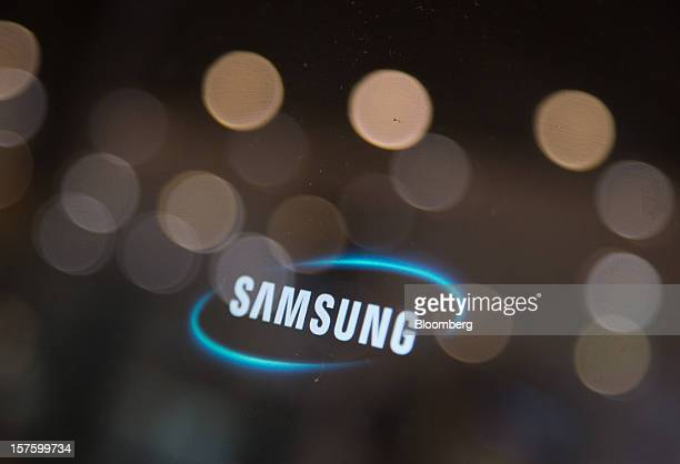 The Samsung Electronics Co logo is displayed on a computer screen at the company's flagship store in Seoul South Korea on Wednesday Dec 5 2012...