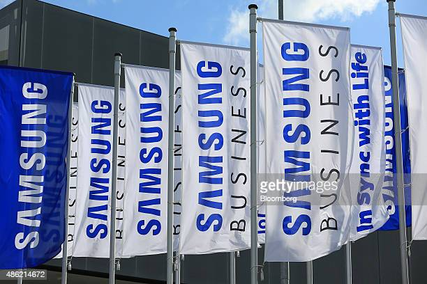 The Samsung Electronics Co logo sits on banners flying outside the Messe Berlin exhibition center ahead of the IFA International Consumer Electronics...