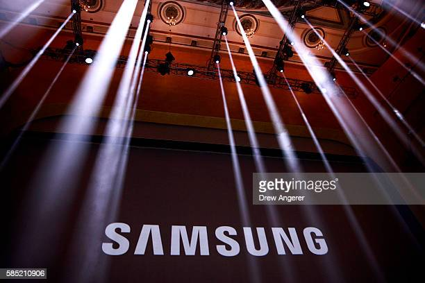 The Samsung logo is displayed on a screen prior to the start of a launch event for the Samsung Galaxy Note 7 at the Hammerstein Ballroom August 2...