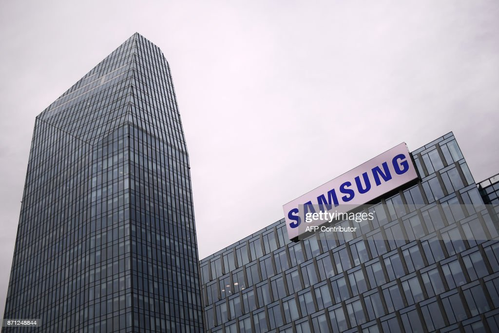 The Samsung logo is displayed on the facade of the Samsung headquarters in Milan on November 7, 2017. /