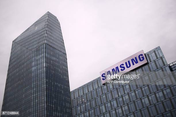 The Samsung logo is displayed on the facade of the Samsung headquarters in Milan on November 7 2017 / AFP PHOTO / MARCO BERTORELLO