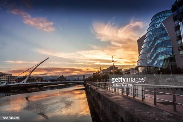 The Samuel Beckett Bridge over the river Liffey and The Convention Center Dublin as the Sun sets in Dublin Ireland 19 August 2015