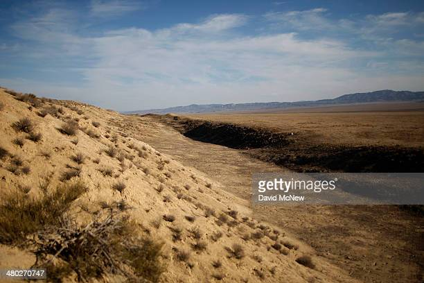 The San Andreas Fault rift zone is seen on the west side of Temblor Ridge which divides it from the oil fields of the Monterey Shale formation where...