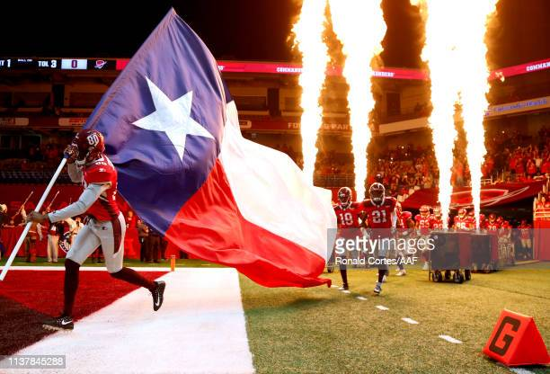 The San Antonio Commanders and the Texas flag take the field before the start of the Alliance of American Football game against the Salt Lake...