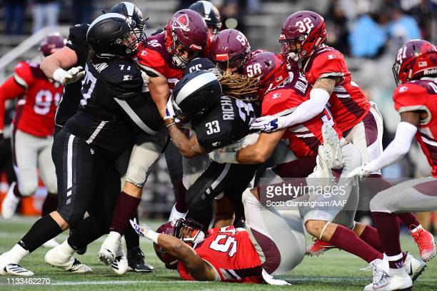 The San Antonio Commanders defense attempts to tackle TrentRichardson of the Birmingham Iron during the second half in an Alliance of American...