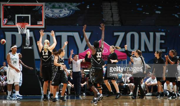 The San Antonio Silver Stars celebrate the last second victory over the Minnesota Lynx on August 9 2009 at the Target Center in Minneapolis Minnesota...