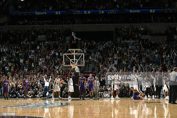 The San Antonio Spurs and fans celebrate as the the Spurs beat the Phoenix Suns 8382 on a last second shot by Anthony Carter during opening night of...
