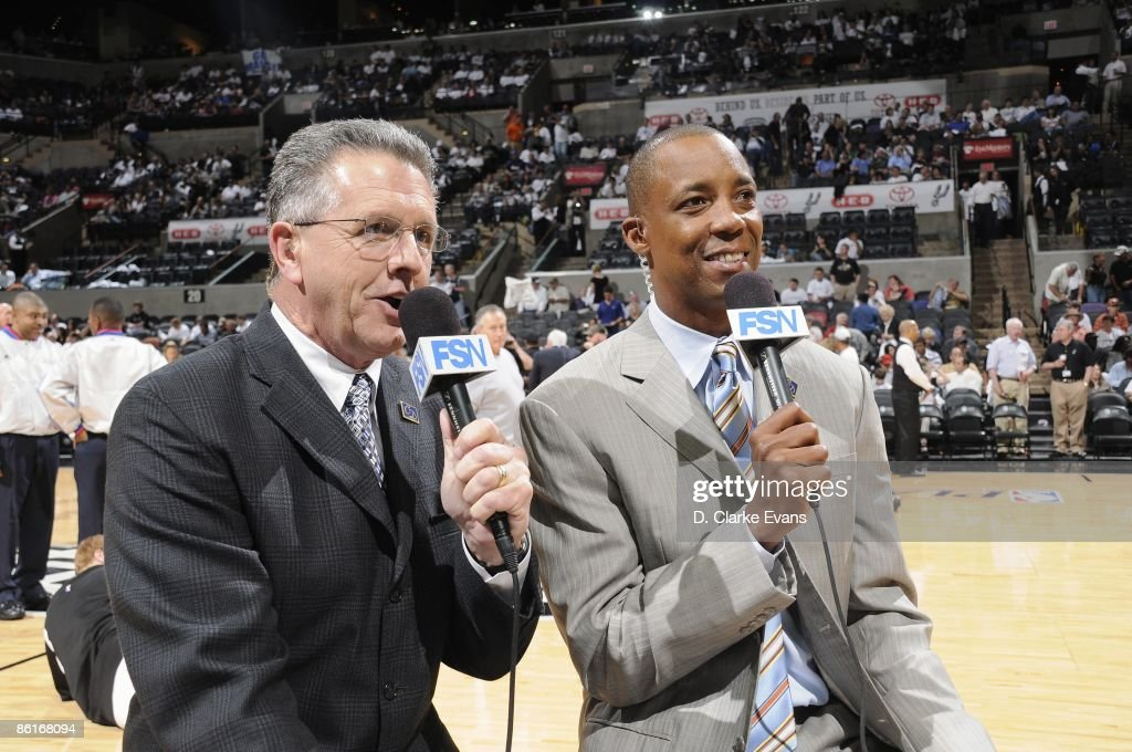 The San Antonio Spurs broadcast team of Bill Land and Sean Elliott talk prior to Game One of the Western Conference Quarterfinals against the Dallas Mavericks during the 2009 NBA Playoffs at AT&T Center on April 18, 2009 in San Antonio, Texas. The Mavericks won 105-97.