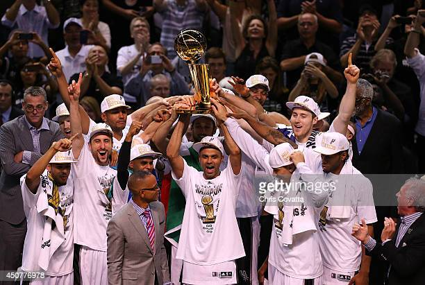 The San Antonio Spurs celebrate after defeating the Miami Heat in Game Five of the 2014 NBA Finals at the ATT Center on June 15 2014 in San Antonio...