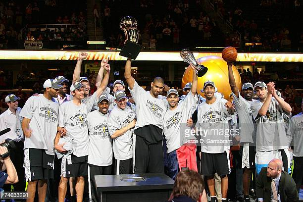 The San Antonio Spurs celebrate with the Larry O'Brien NBA Championship Trophy after their 8382 win against the Cleveland Cavaliers in Game Four of...
