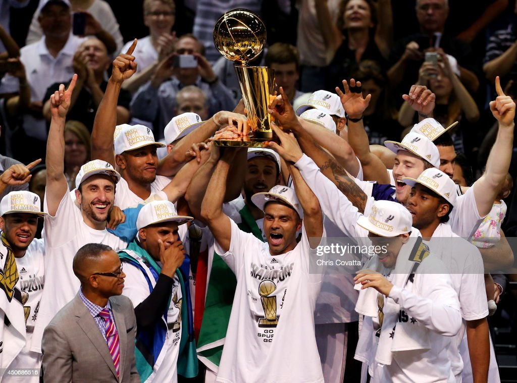 The San Antonio Spurs celebrate with the Larry O'Brien trophy after defeating the Miami Heat to win the 2014 NBA Finals at the AT&T Center on June 15, 2014 in San Antonio, Texas.