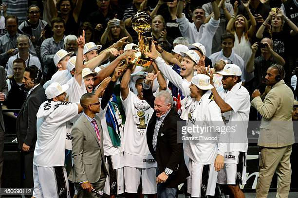 The San Antonio Spurs celebrate with the Larry O'Brien trophy after defeating the Miami Heat to win the 2014 NBA Finals in Game Five of the 2014 NBA...