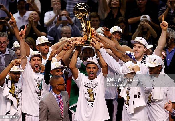 The San Antonio Spurs celebrate with the Larry O'Brien trophy after defeating the Miami Heat to win the 2014 NBA Finals at the ATT Center on June 15...